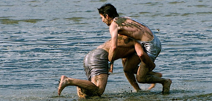 Two-men-fighting-on-the-beach-by-Patrick-Doheny-Creative-Commons